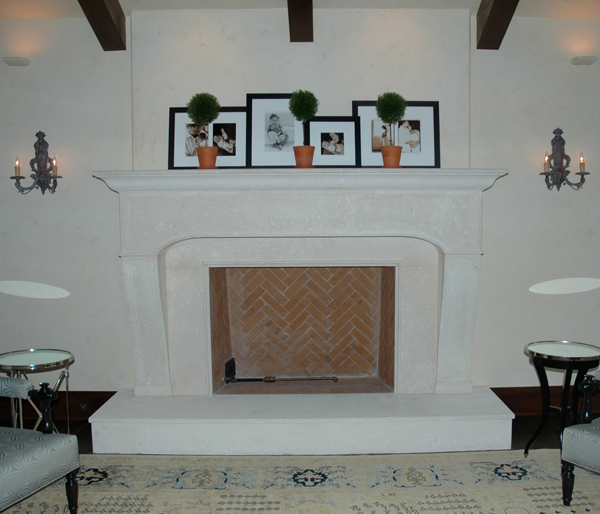 french_inspired_custom_stone_carved_fireplace